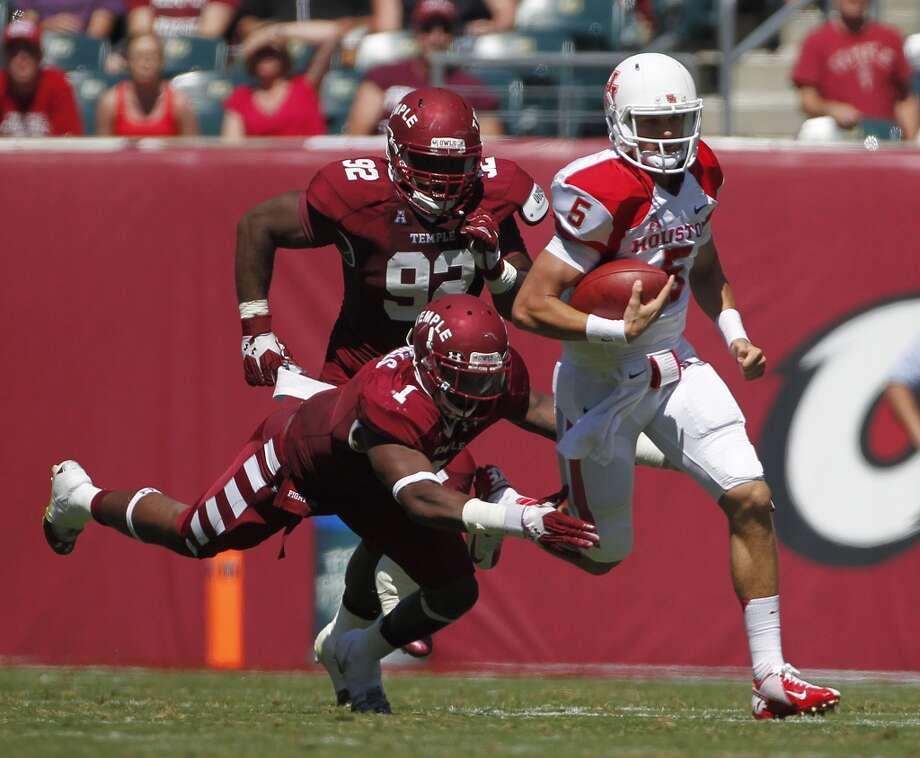 Sept. 7: Houston 22, Temple 13Record: 2-0UH quarterback John O'Korn scrambles against the Temple defense. Photo: Johnny Hanson, Houston Chronicle