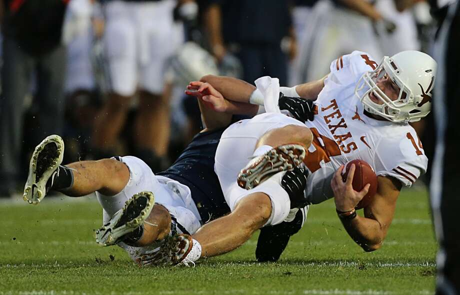 Alani Fua #5 of BYU sacks quarterback David Ash #14 of the Longhorns. Photo: George Frey, Getty Images