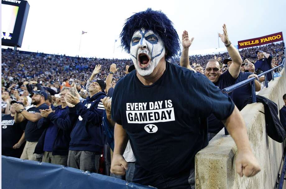 A fan of the BYU Cougars cheers after a touchdown. Photo: George Frey, Getty Images