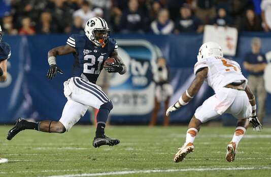 Jamaal Williams #21 of BYU looks to run past Josh Turner #5 of the Longhorns. Photo: George Frey, Getty Images