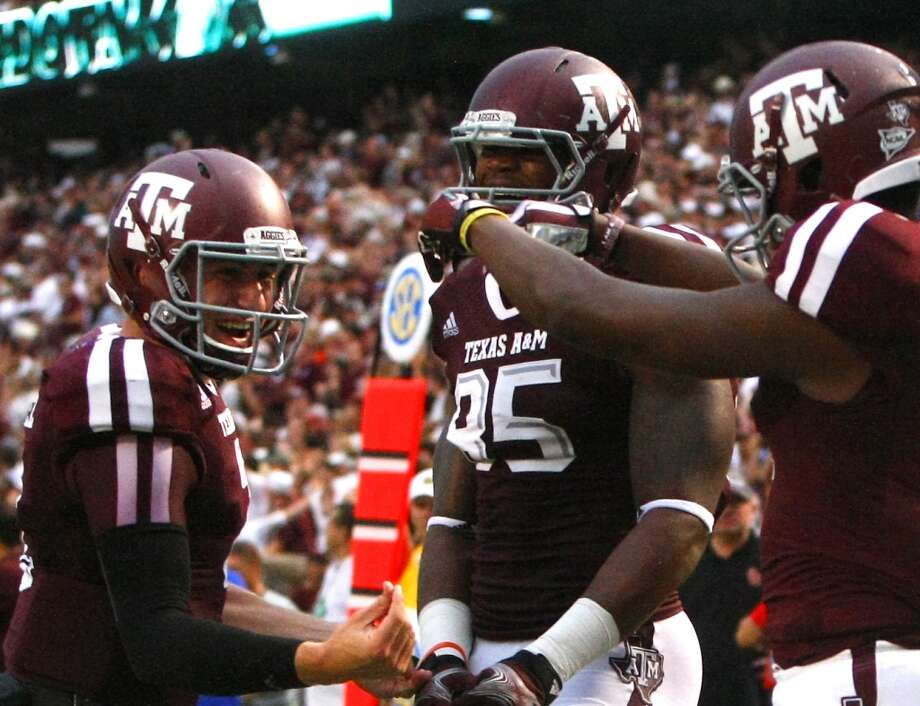 Texas A&M Aggies quarterback Johnny Manziel, left, gestures to wide receiver Ja'Quay Williams, right, after he caught a touchdown pass. Photo: Cody Duty, Houston Chronicle