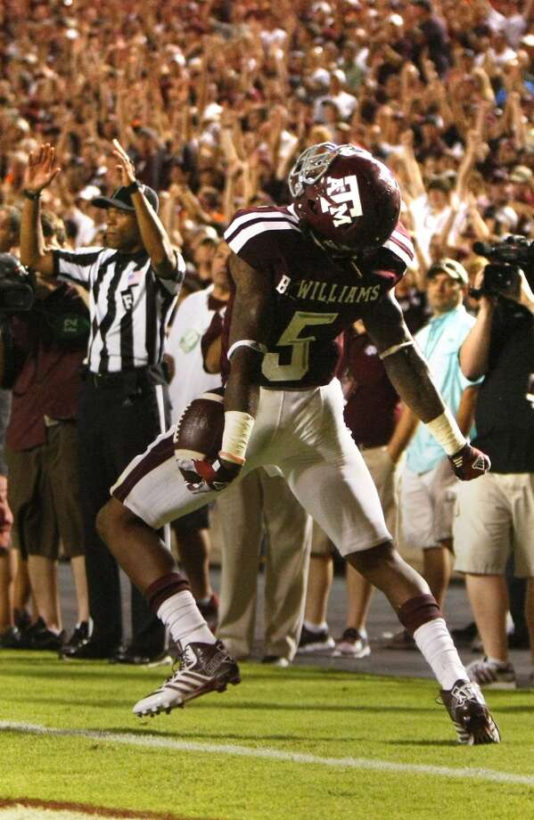 Texas A&M Aggies running back Brandon Williams celebrates after scoring a touchdown. Photo: Cody Duty, Houston Chronicle