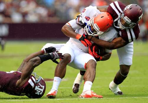 Texas A&M Aggies defensive back Toney Hurd Jr. and defensive back Tramain Jacobs, right, take down Sam Houston State Bearkats wide receiver Richard Sincere. Photo: Cody Duty, Houston Chronicle