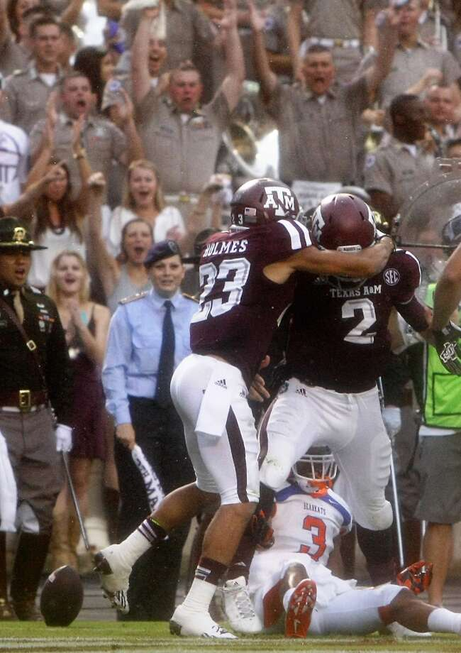 Texas A&M Aggies wide receiver Sabian Holmes, left, congratulates quarterback Johnny Manziel after Manziel ran it to the one-yard line. Photo: Cody Duty, Houston Chronicle