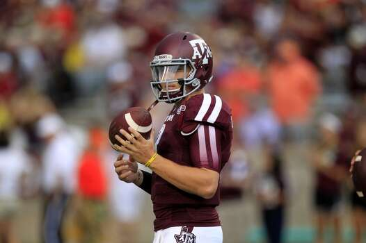 Texas A&M quarterback Johnny Manziel warms up before playing Sam Houston State. Photo: Cody Duty, Houston Chronicle
