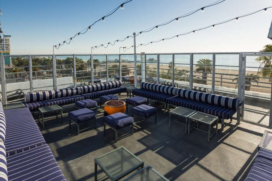 With views like this,  the comfy deck chairs at  Suite 700 -- the penthouse lounge of Hotel Shangri-La in Santa Monica -- aren't usually this empty. Photo: Hotel Shangri-La