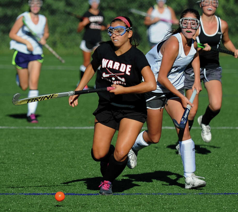 Fairfield Warde's Becca Mitrii beats a Staples High School forward to the ball during a scrimmage on Friday, Sept. 6. Mitri is one of the top returning defenders on a Mustangs squad that boasts more depth than in recent years. Photo: Christian Abraham / Connecticut Post