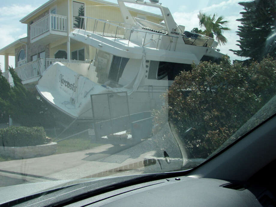 The North Shore photos show large boats that washed onto the island and in yards, as well as some of the damage to homes. Photo: Karen Heck