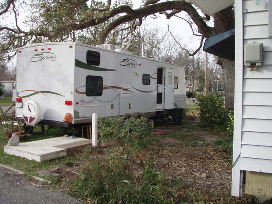 Temporary home was the travel trailer I rented and had placed in our front yard while repairs were made to our home.  My teenage son and I lived there with our dogs and cat for five months. We spent the first three months at a friend's house. Photo: Karen Heck