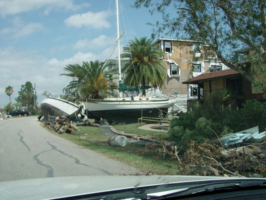 Large boats washed onto the island and in yards. Photo: Karen Heck