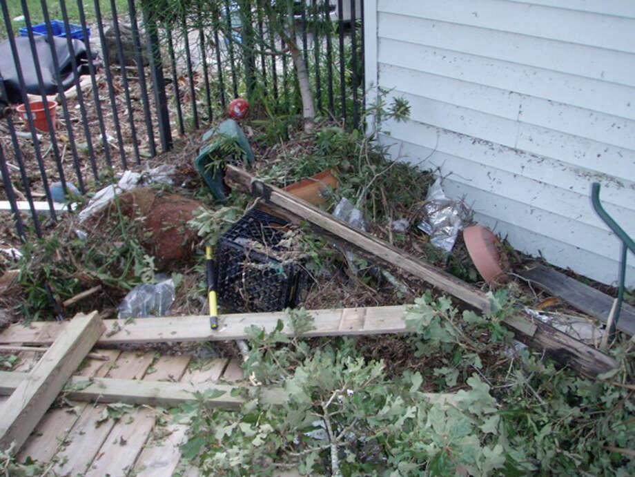 Debris washed onto my property, including a punching bag and a large landscape boulder. Photo: Karen Heck