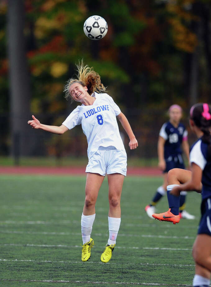 Fairfield Ludlowe midfielder Krissy Bradley, heading a ball against Wllton last season, gives the Falcons senior leadership this fall offensively and defensively. Photo: Christian Abraham / Connecticut Post