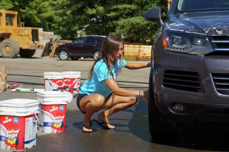 Members of Staples High School sponsored their annual car wash on Sunday morning. Photo: Todd Tracy / Westport News
