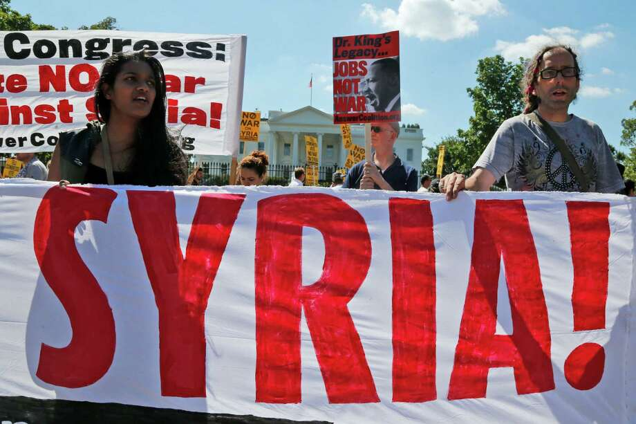 Anti-war demonstrators protest against possible U.S. military action in Syria in front of the White House in Washington, Saturday, Sept. 7, 2013. Photo: AP