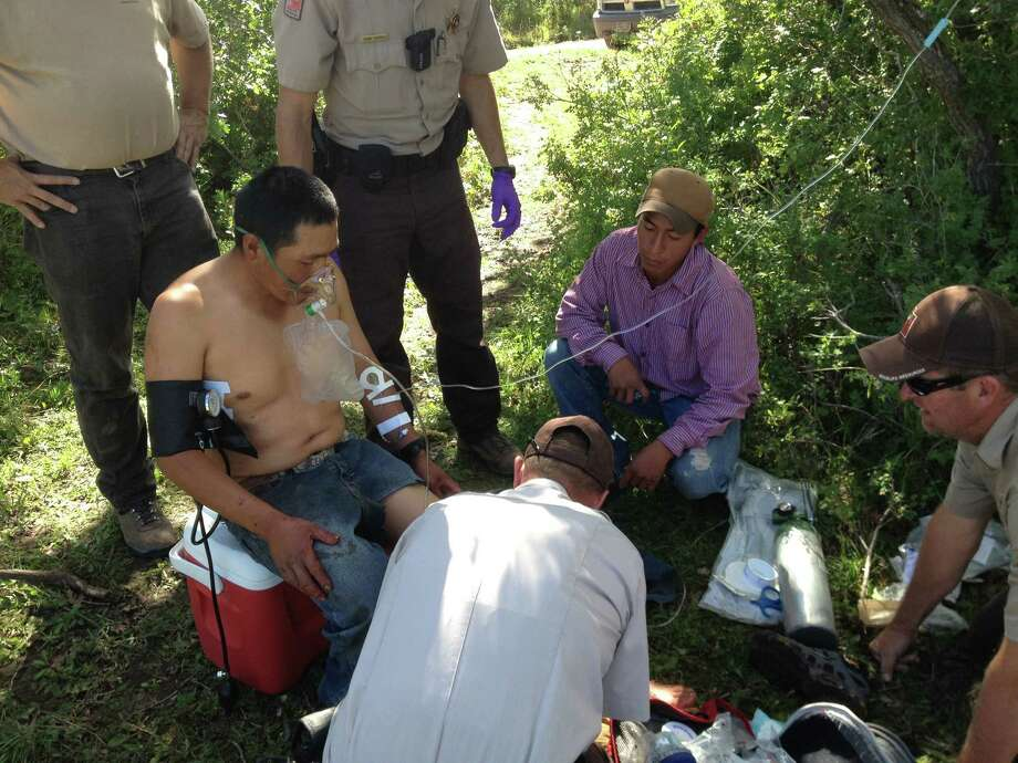 This image provided by the Utah Division of Wildlife Resources shows Peruvian sheepherder Hugo Macha, 31, being assisted by officers with the Utah Division of Wildlife Resources in the mountains in eastern Utah, near Moab, after being gored by an elk Tuesday Sept. 3, 2013. Macha told officials he waited in hopes that he'd be found by hunters, and tried to call for help on his cellphone, but wasn't getting service. Early the next day, he started a long walk to find a fellow shepherd about five miles away. Photo: AP