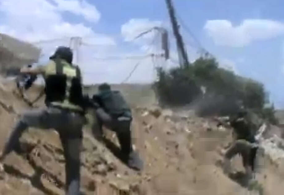 In this image taken from video obtained from the Shaam News Network, which has been authenticated based on its contents and other AP reporting, Free Syrian army fighters fire their weapons during clashes with government forces, unseen, in Daraya, a suburb of Damascus, Syria, Wednesday, Sept. 4, 2013. Photo: AP