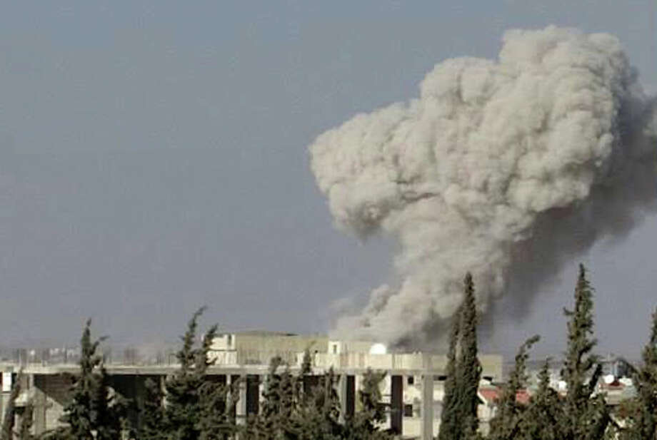 In this Wednesday, Sept. 4, 2013 citizen journalism image provided by Edlib News Network, ENN, which has been authenticated based on its contents and other AP reporting, smoke rises from buildings due to an air strike that hit Sarakeb, Idlib province, Syria. Photo: AP