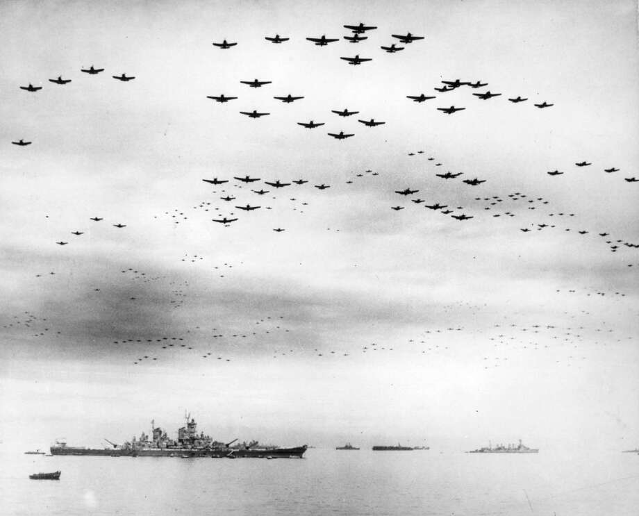 FILE - In this Sept. 2, 1945 file photo, F4U and F6F fighter planes are flying in formation over the USS Missouri, while the surrender ceremonies to end World War II take place aboard the U.S. Navy battleship. Photo: AP