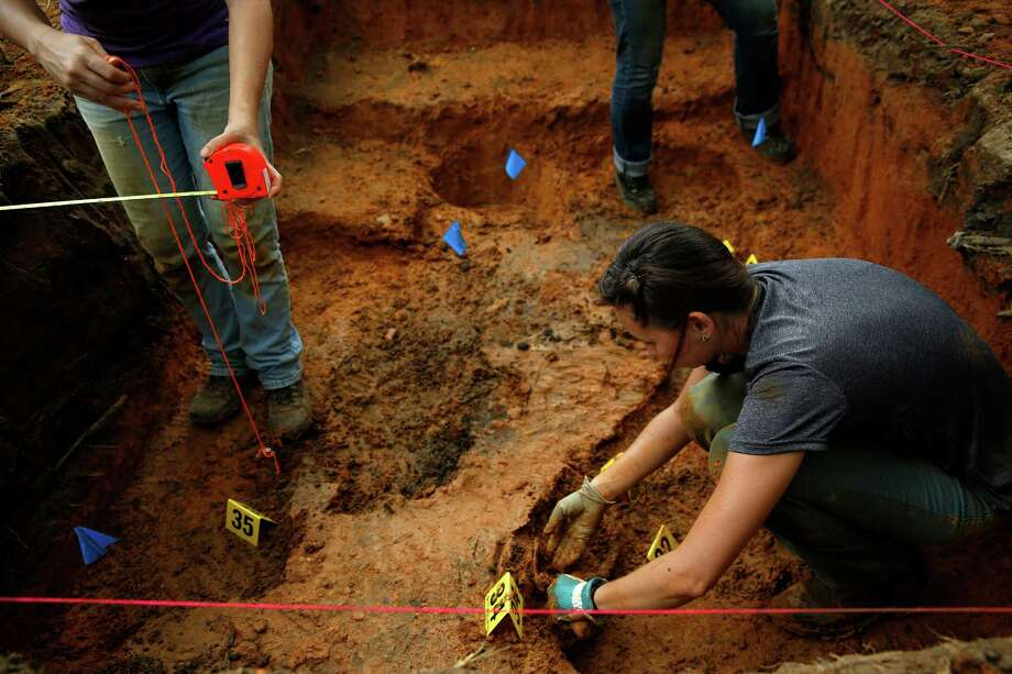 University of South Florida student Ashley Humphries exhumes a grave at the Arthur G. Dozier School for Boys in Marianna, Fla. on Sunday, Sept. 1, 2013. Ex-inmates from the 1950s and 1960s detailed horrific beatings at the notorious former reform school. Photo: AP