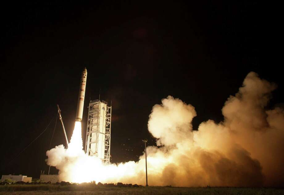 In this photo provided by NASA, an unmanned Minotaur rocket carries NASA's newest robotic explorer, the LADEE spacecraft, which is charged with studying the lunar atmosphere and dust, after launching to the moon from NASA's Wallops Flight Facility on Virginia's Eastern Shore on Friday, Sept. 6, 2013. Photo: AP