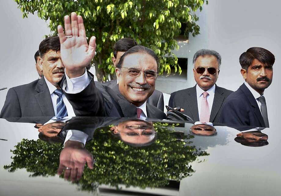 Zardari says goodbye:Outgoing President Asif Ali Zardari waves following a farewell ceremony at   President House in Islamabad, Pakistan. Zardari stepped down Sunday, becoming the first democratically elected president in the country's history to complete his   full, five-year tenure in office. Photo: Anjum Naveed, Associated Press
