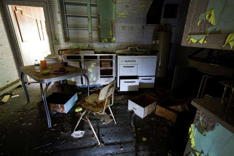 A thick layer of dust and scattered trash covers the kitchen of a guard house in Washington's ghost town of Lester. Photo: JORDAN STEAD, SEATTLEPI.COM / SEATTLEPI.COM