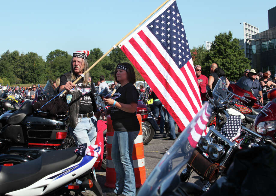 Jim Hinkley, of Southport, and Betsy Fischer, of Greenwich, ride in the 13th annual CT United Ride, the largest 9/11 Tribute in CT, in Norwalk on Sunday, Sept. 8, 2013. Photo: BK Angeletti, B.K. Angeletti / Connecticut Post freelance B.K. Angeletti