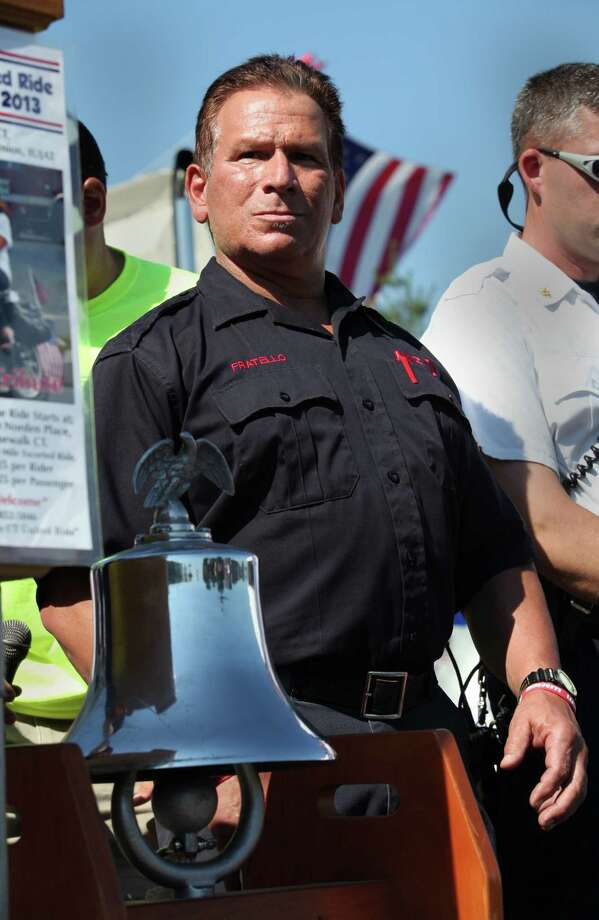 Norwalk firefighter Mike Fratello rings the bell 11 times at the 13th annual CT United Ride, the largest 9/11 Tribute in CT, in Norwalk on Sunday, Sept. 8, 2013. Photo: BK Angeletti, B.K. Angeletti / Connecticut Post freelance B.K. Angeletti