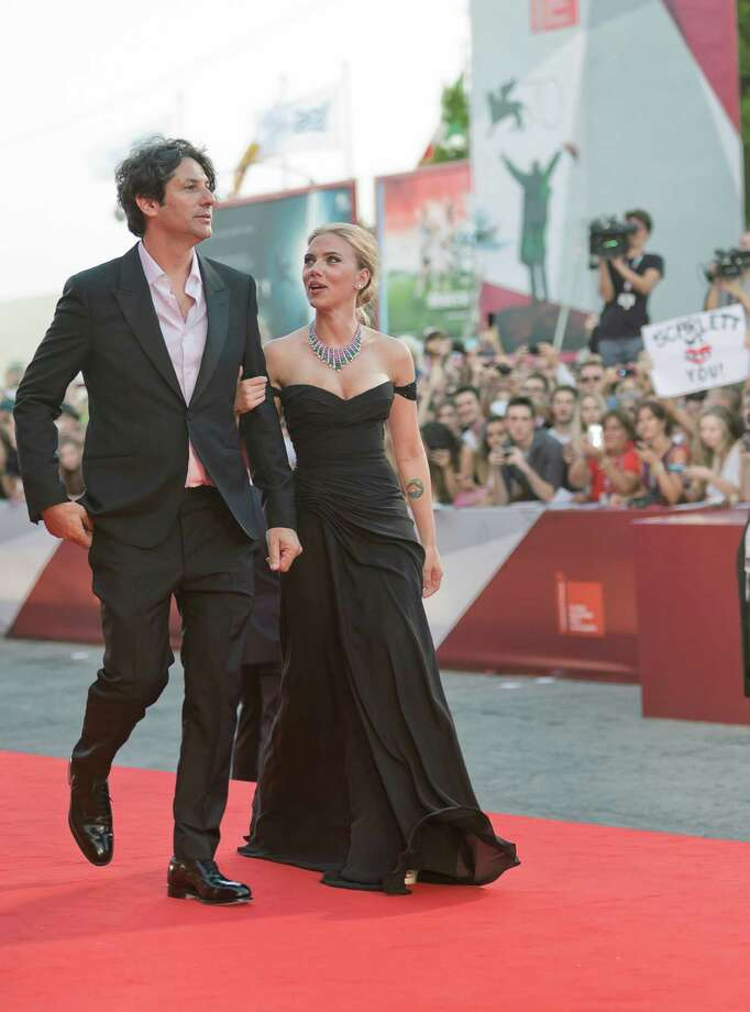 Actress Scarlett Johansson, right, arrives with director Jonathan Glazer on the red carpet for the screening of the film Under The Skin at the 70th edition of the Venice Film Festival held from Aug. 28 through Sept. 7, in Venice, Italy, Tuesday, Sept. 3, 2013. Photo: AP