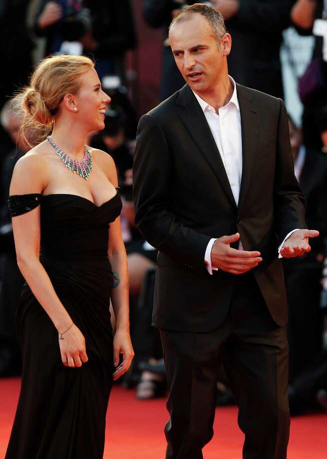 Actress Scarlett Johansson and James Wilson arrive on the red carpet for the screening of the film Under The Skin at the 70th edition of the Venice Film Festival held from Aug. 28 through Sept. 7, in Venice, Italy, Tuesday, Sept. 3, 2013. Photo: AP