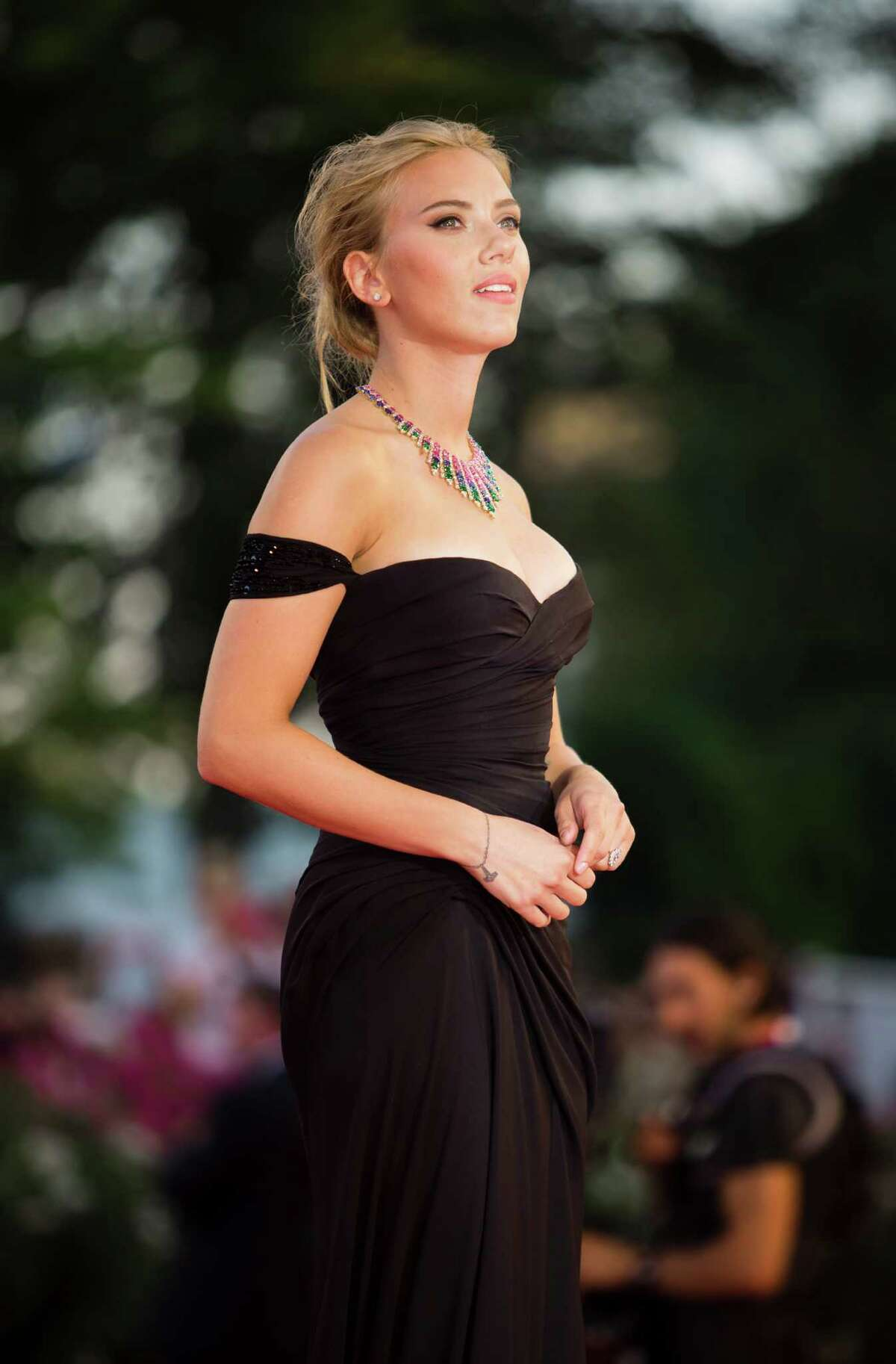 Actress Scarlett Johansson arrives on the red carpet for the screening of the film Under The Skin at the 70th edition of the Venice Film Festival held from Aug. 28 through Sept. 7, in Venice, Italy, Tuesday, Sept. 3, 2013.