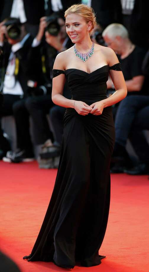 Actress Scarlett Johansson poses for photographers as she arrives on the red carpet for the screening of the film Under The Skin at the 70th edition of the Venice Film Festival held from Aug. 28 through Sept. 7, in Venice, Italy, Tuesday, Sept. 3, 2013. Photo: AP