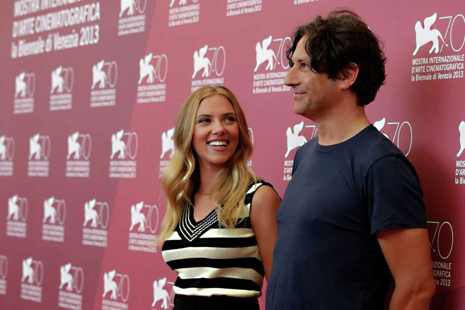 From left, actress Scarlett Johansson and director Jonathan Glazer pose for photographers during the photo call for the film Under The Skin at the 70th edition of the Venice Film Festival held from Aug. 28 through Sept. 7, in Venice, Italy, Tuesday, Sept. 3, 2013. Photo: AP