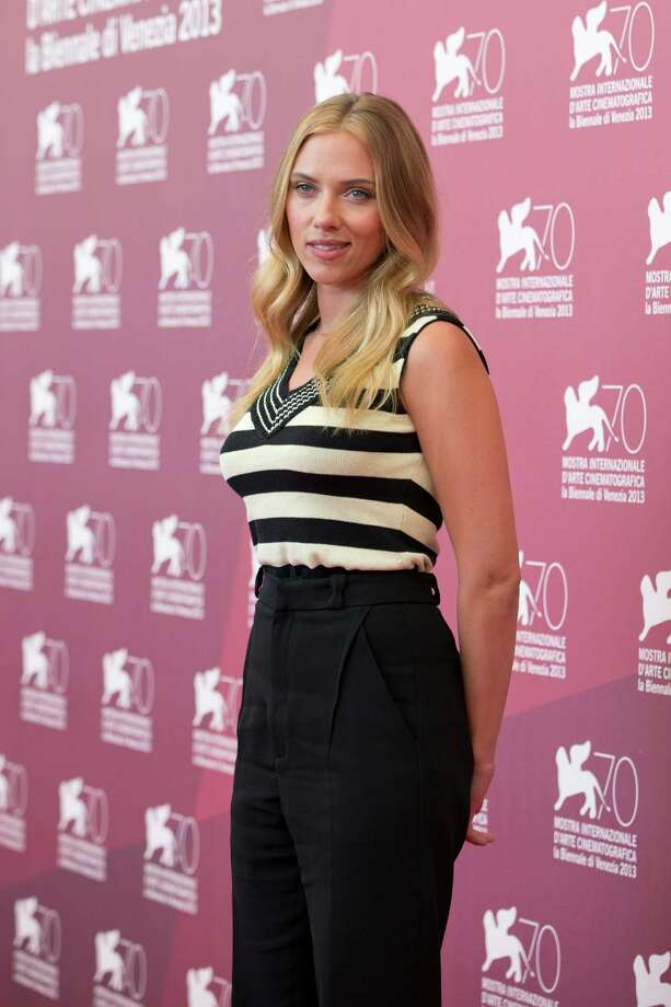 Actress Scarlett Johansson poses for photographers during the photo call for the film Under The Skin at the 70th edition of the Venice Film Festival held from Aug. 28 through Sept. 7, in Venice, Italy, Tuesday, Sept. 3, 2013. Photo: AP