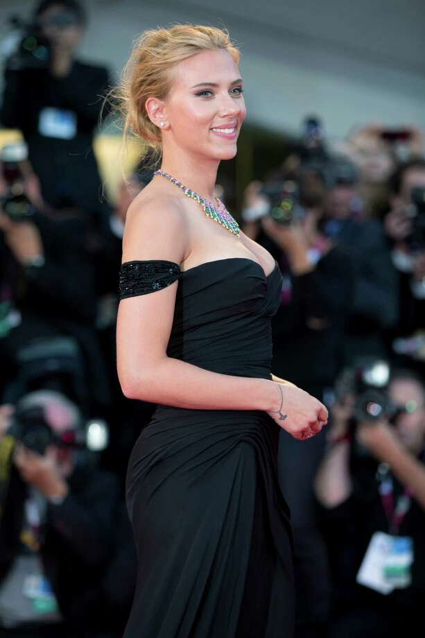 Actress Scarlett Johansson poses for photographers on the red carpet for the screening of the film Under The Skin at the 70th edition of the Venice Film Festival held from Aug. 28 through Sept. 7, in Venice, Italy, Tuesday, Sept. 3, 2013. Photo: AP