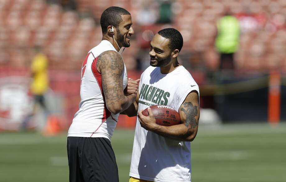 San Francisco 49ers quarterback Colin Kaepernick, left, greets Green Bay Packers quarterback Seneca Wallace before an NFL football game in San Francisco, Sunday, Sept. 8, 2013. (AP Photo/Marcio Jose Sanchez) Photo: Marcio Jose Sanchez, Associated Press