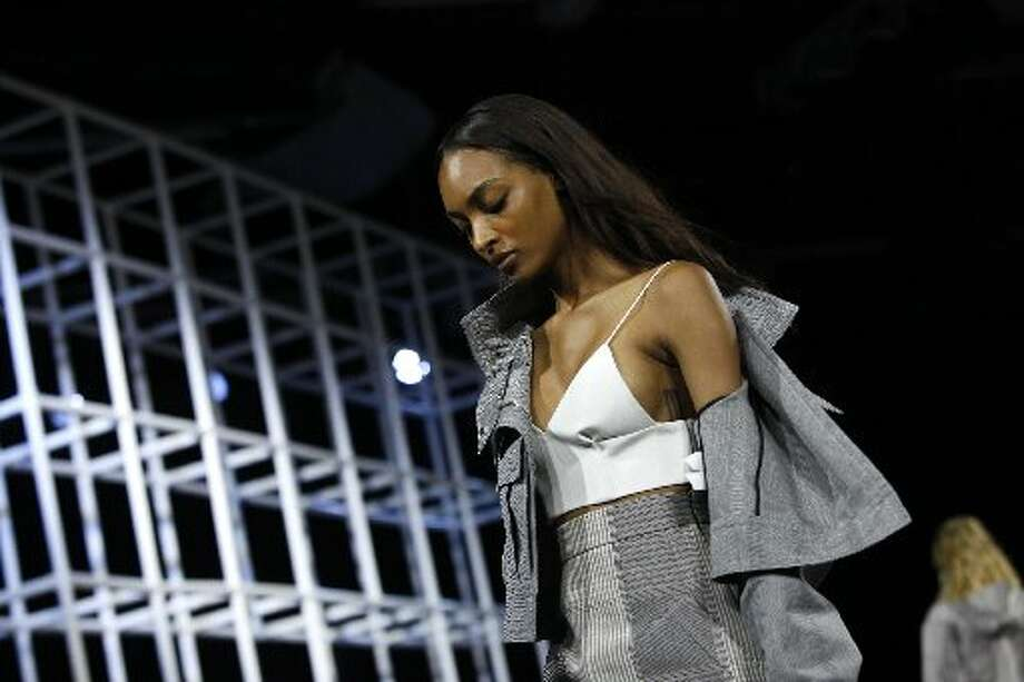 Alexander Wang's Spring 2014 collection -- bare midriffs, pleated skirts and babydolls -- spoke uniquely to his American aesthetic. Photo: Joshua Lott, AFP/Getty