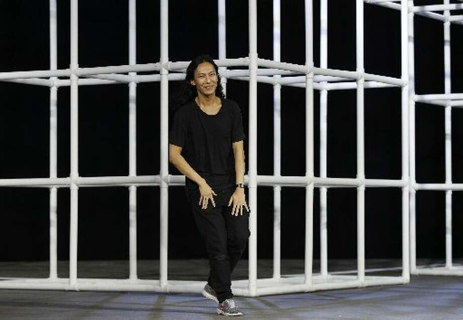 Designer Alexander Wang greets the crowd at the end of the show. Photo: Joshua Lott, AFP/Getty