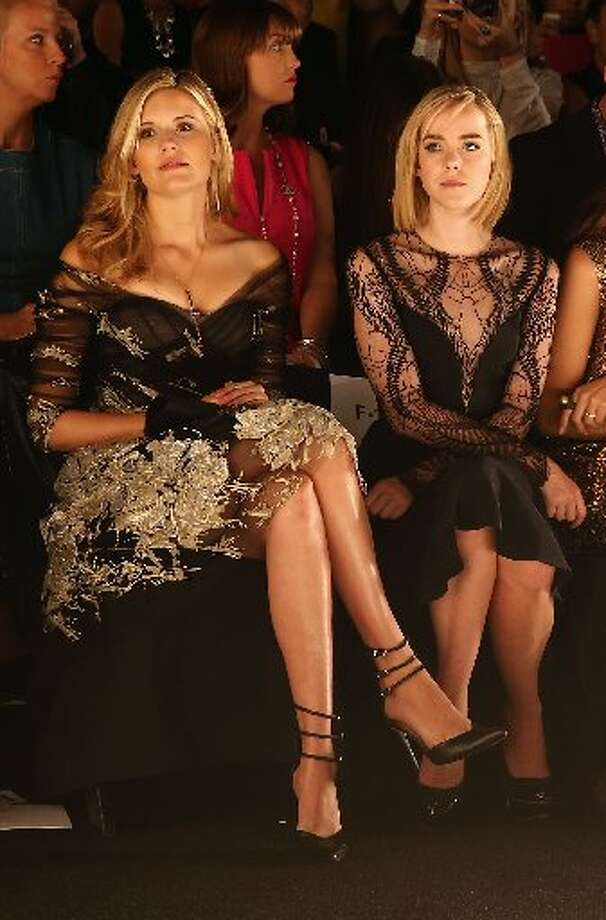 Maggie Grace (L) and Jena Malone attend the Monique Lhuillier fashion show. Photo: Neilson Barnard, Getty