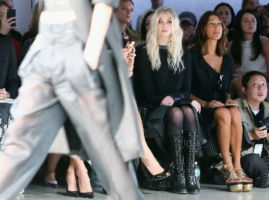 Taylor Momsen takes in the show from the front row. Photo: Getty