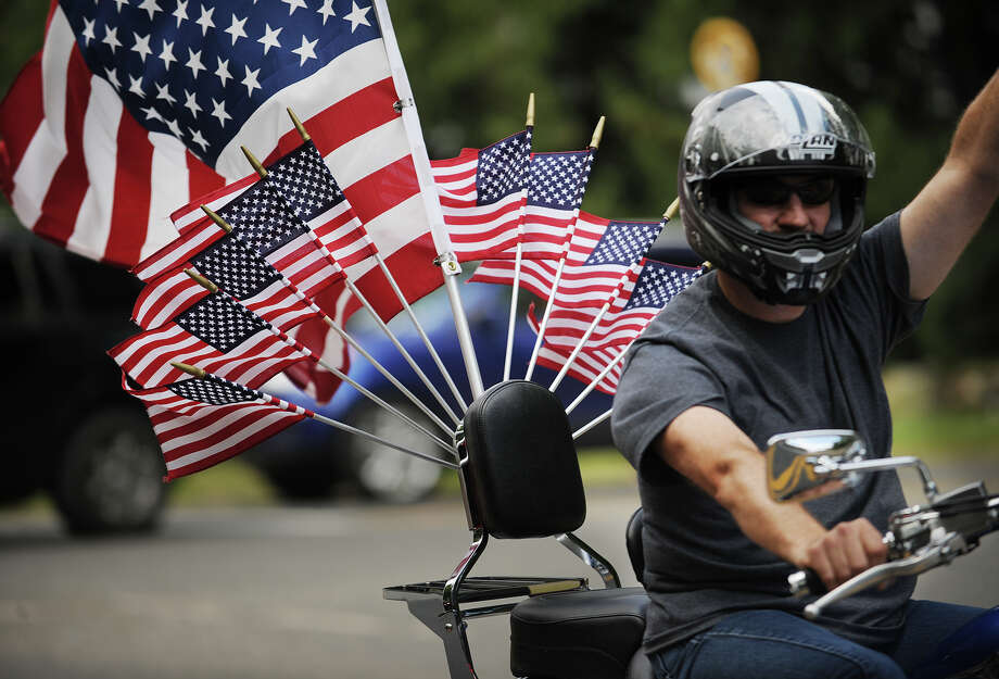 His motorcycle decked out in American flags, a rider participates in the 13th annual CT United Ride on Park Avenue in Fairfield, Conn. on Sunday, September 8, 2013. The event is the largest single charity ride in New England as well as the largest 9/11 tribute in the State of Connecticut. Photo: Brian A. Pounds / Connecticut Post