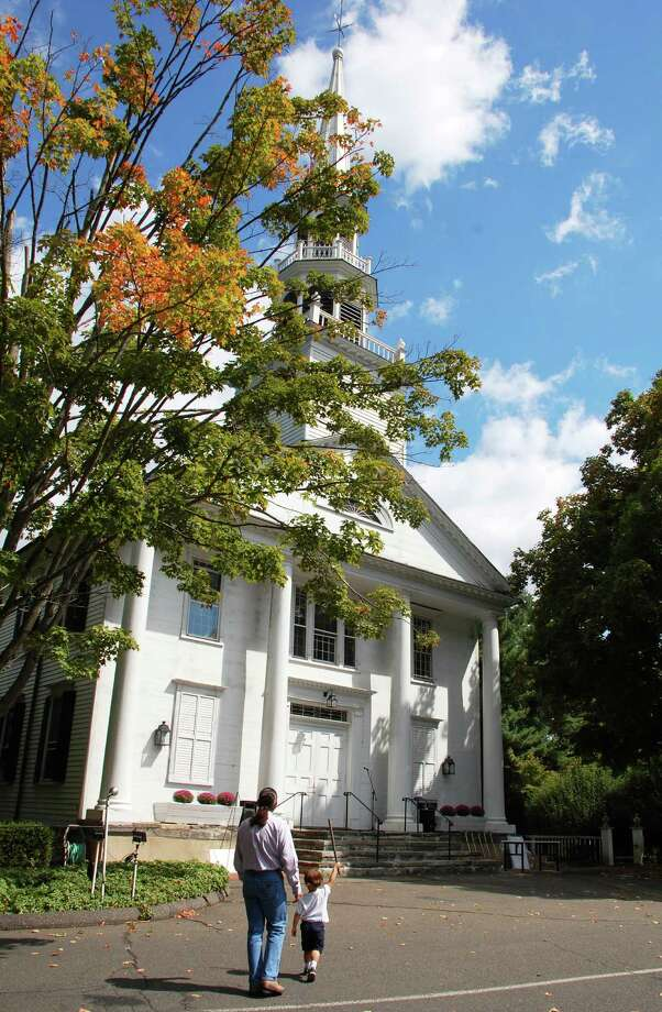 A ceremony Sunday marked the start of reconstruction at Saugatuck Congregational Church, which has not been in use since November 2011 when a large fire destroyed the rear portion of the church complex. Photo: Jarret Liotta / Westport News contributed