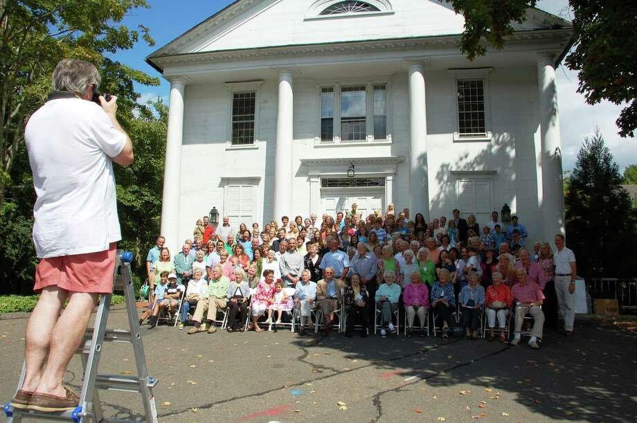 Several hundred members of Saugatuck Congregational Church posed for a picture Sunday on the front steps of the historic sanctuary during a program that marked the start of reconstruction in the wake of a November 2011 fire. Photo: Jarret Liotta / Westport News contributed