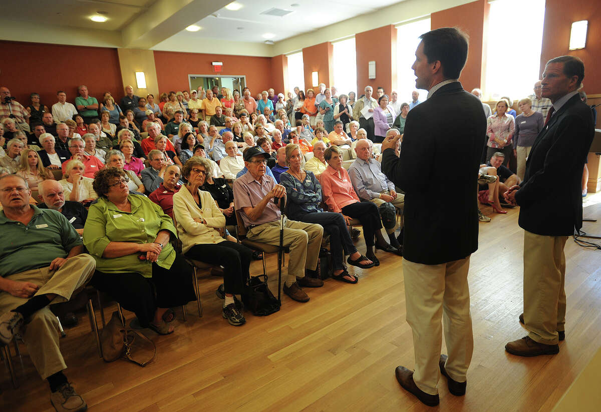 Rep. Jim Himes, left, and Sen. Richard Blumenthal address a packed house during Himes' Town Hall Meeting on Syria at the Darien Public Library in Darien, Conn. on Sunday, September 8, 2013.