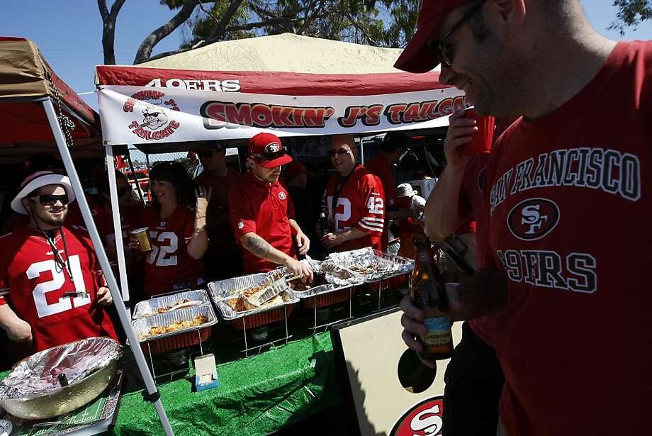 The crew of Smokin' J's Tailgate, which serves a wide-ranging buffet of pregame fare, won last year's 49ers Tailgater of the Year award and aim to defend their award in the team's last season at Candlestick Park. Photo: Michael Short, The Chronicle