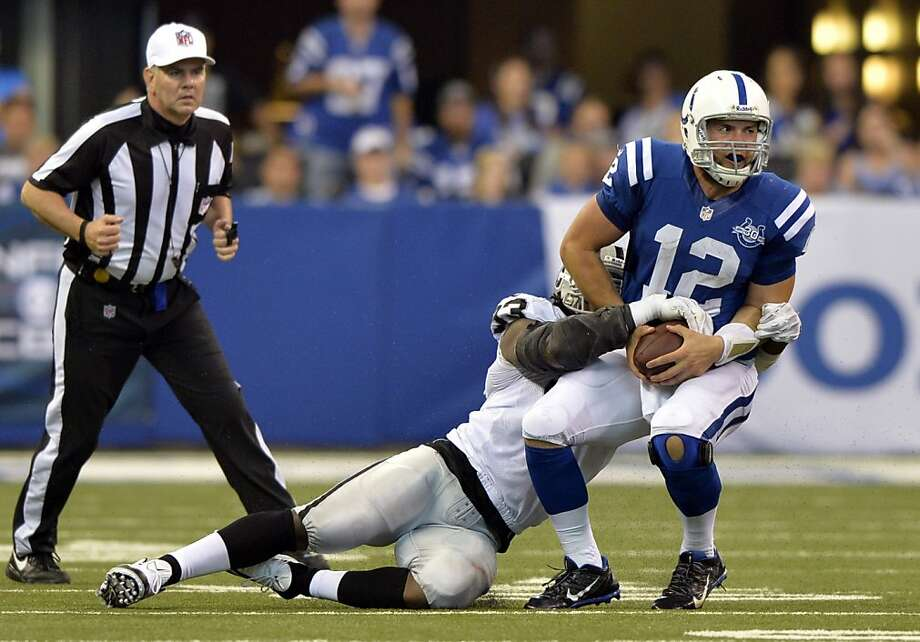Jason Hunter sacks Andrew Luck in the second half, one of the Raiders' four sacks in a game that marked a turnaround for Oakland's defense after four poor showings in the preseason. Photo: Doug McSchooler, Associated Press