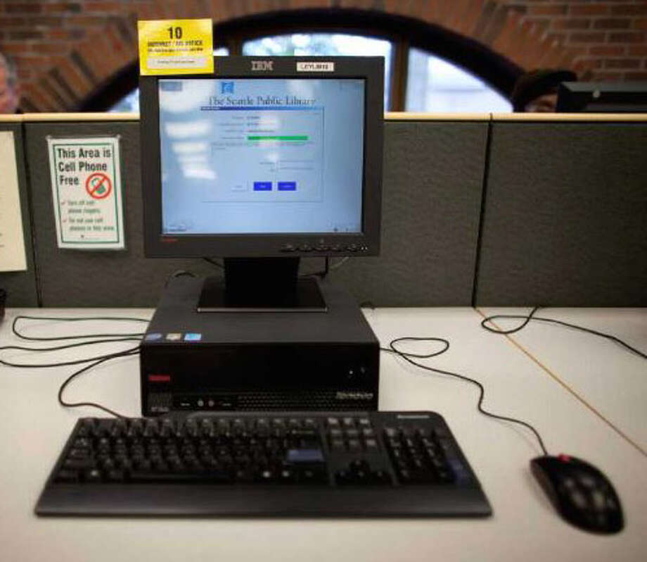 A computer is shown at the  Lake City branch of the Seattle Public Library in 2012, when a woman complained about a man openly watching porn on a computer. The librarian responded that it was not the responsibility of staffers to monitor the computers. Photo: JOSHUA TRUJILLO, SEATTLEPI.COM