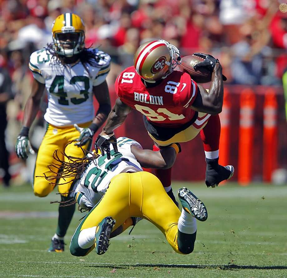 Wide receiver Anquan Boldin is upended by Green Bay safety Jerron McMillian in the first quarter. Boldin caught 13 passes for 208 yards and a touchdown in his debut with the 49ers. Photo: Carlos Avila Gonzalez, The Chronicle