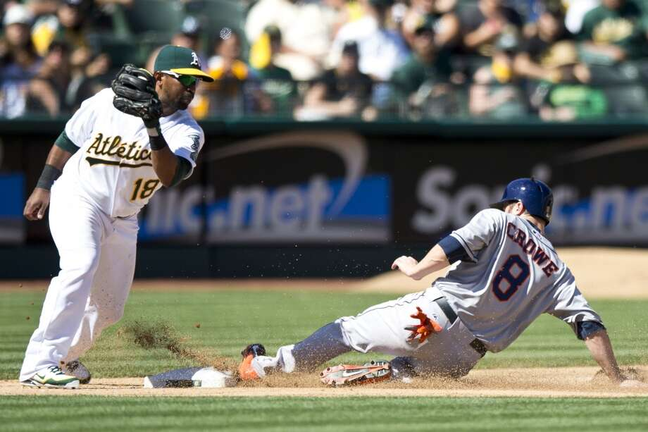 Sept. 8: A's 7, Astros 2Trevor Crowe of the Astros steals third base ahead of a tag from Alberto Callaspo. Photo: Jason O. Watson, Getty Images