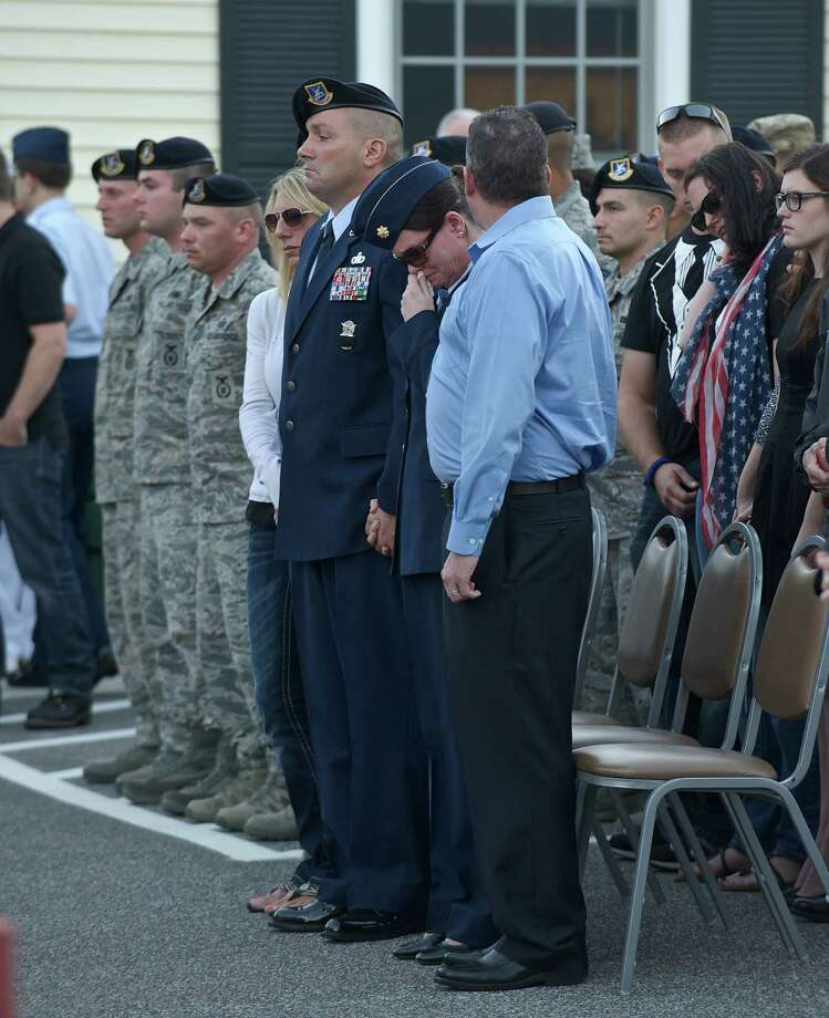 """Parents of Staff Sgt. Todd James """"TJ"""" Labraico Jr, Todd Labraico, left, and Linda Rohatsch, both in uniform, during a vigil for their son in New Fairfield, Conn. On Sunday September 8, 2013. Labraico, age 22, was killed in Afghanistan while serving with the Air National Guard. Photo: H John Voorhees III"""